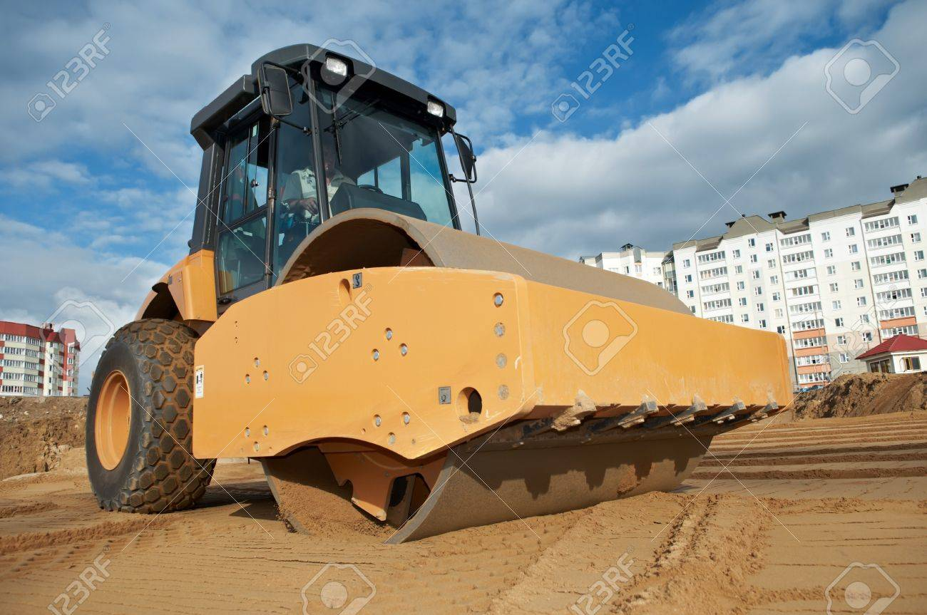 soil vibration roller during sand compacting works at construction site Stock Photo - 7565313