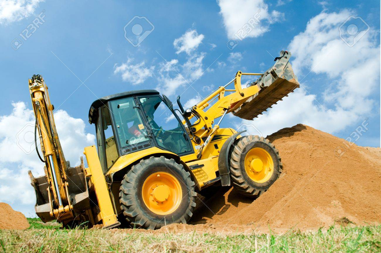 Wheel loader Excavator with backhoe unloading sand at eathmoving works in construction site Stock Photo - 7818023