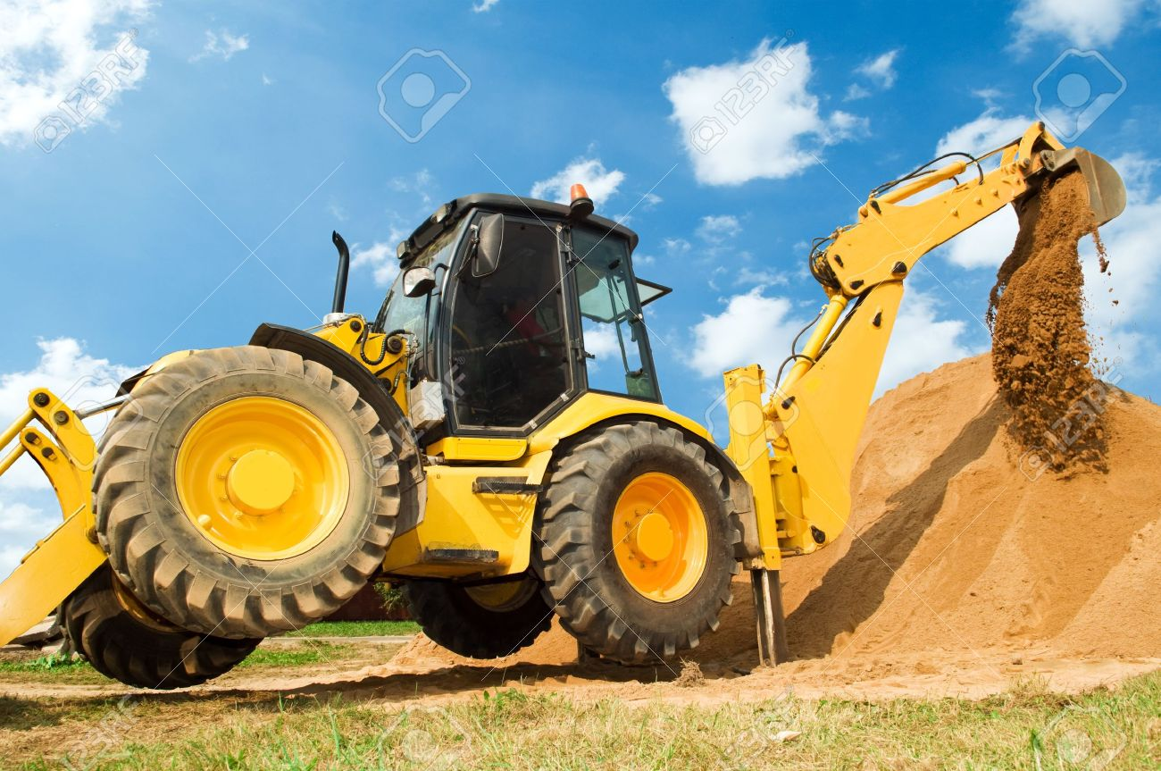 Wheel loader Excavator with backhoe unloading sand at eathmoving works in construction site Stock Photo - 7818027
