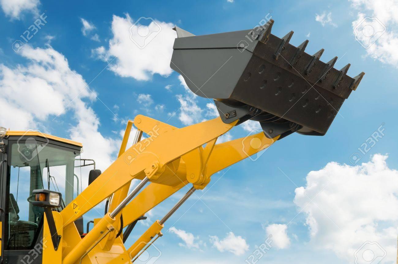 risen loader excavator scoop shovel over blue sky Stock Photo - 7817933