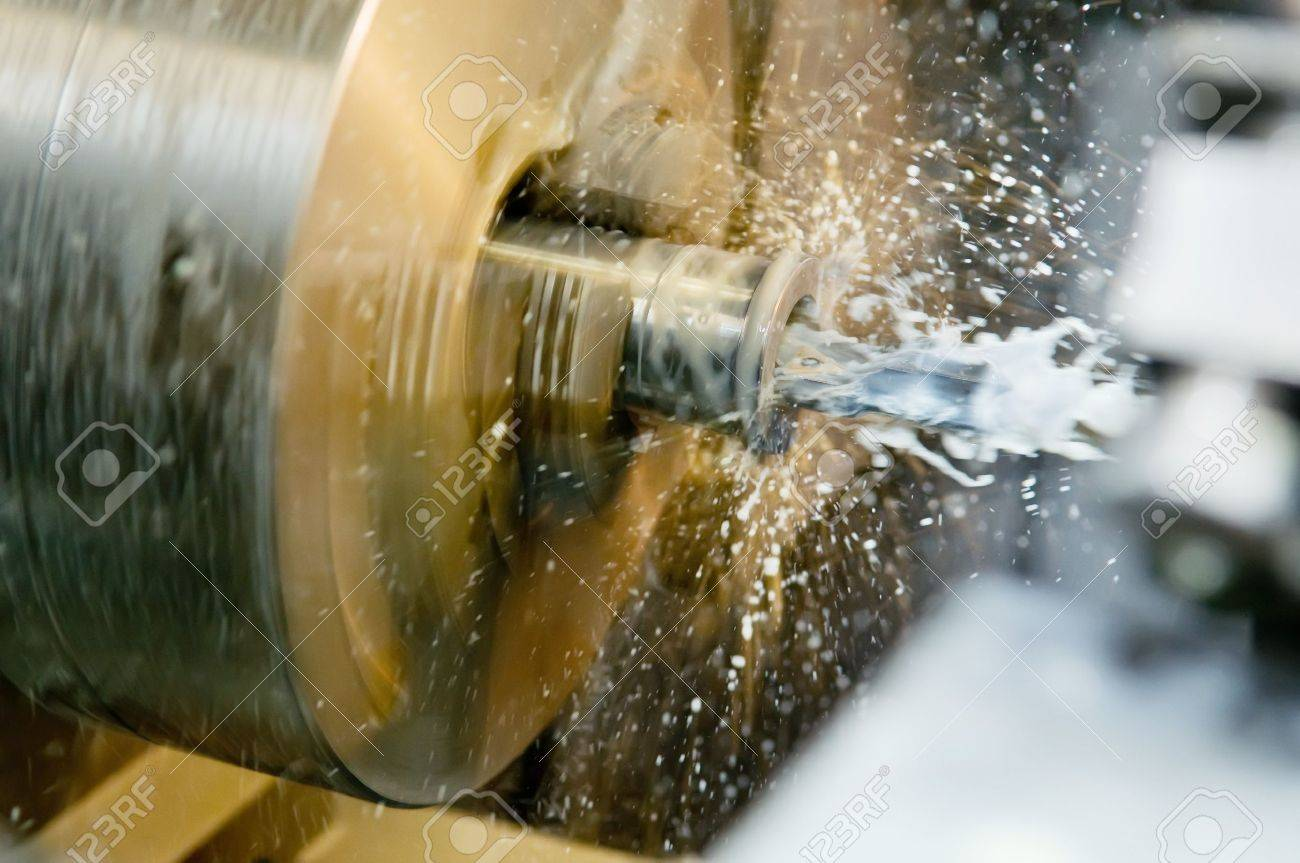 Operation of drilling a hole in blank on turning machine with metal-working coolant Stock Photo - 7817964
