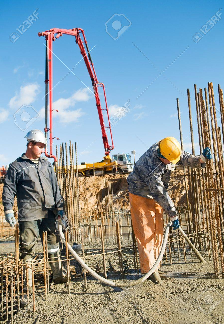 builder laborers works on construction site. Concrete pump and Vibration Stock Photo - 8207161