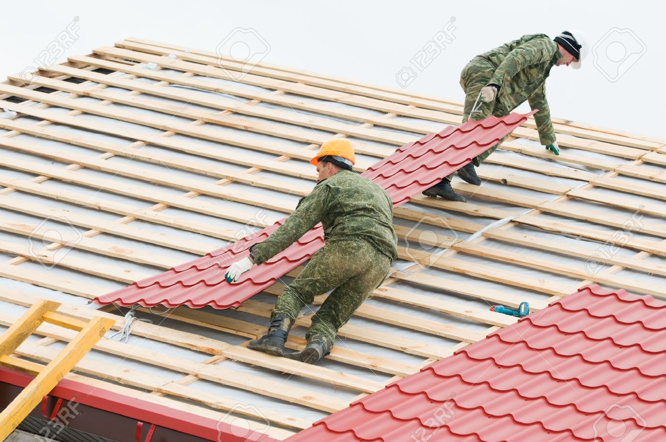 Two Workers On Roof At Works With Metal Tile And Roofing Iron Stock Photo - 8398587 Sc 1 St 123RF Stock Photos  sc 1 st  memphite.com & Roof Works u0026 Photo Of East Texas Roof Works \u0026 Sheet Metal ... memphite.com