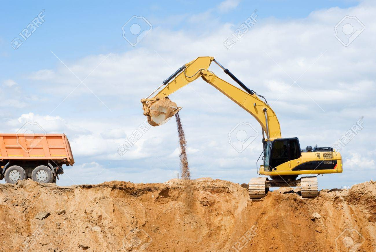 loader excavator loading body of a dump truck tipper at open