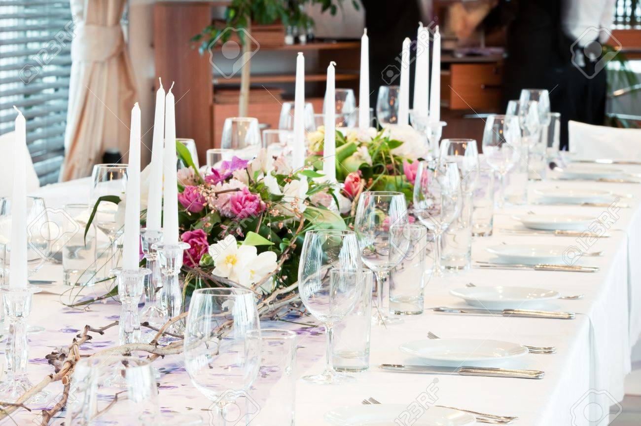 catering table set service with silverware, fresh flowers and glass at restaurant before party Stock Photo - 9233497