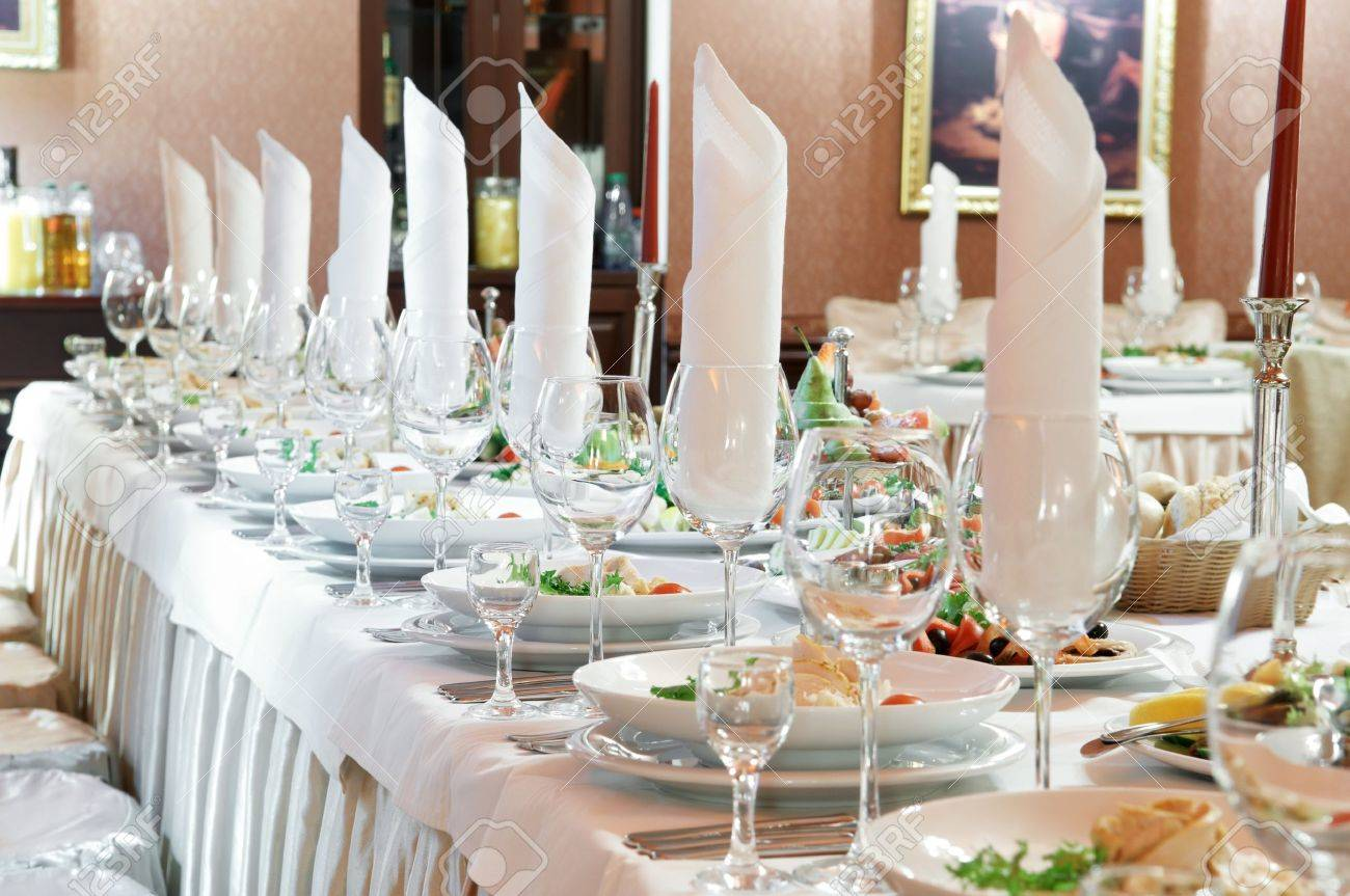 catering table set service with silverware, napkin and glass at restaurant before party Standard-Bild - 9234498