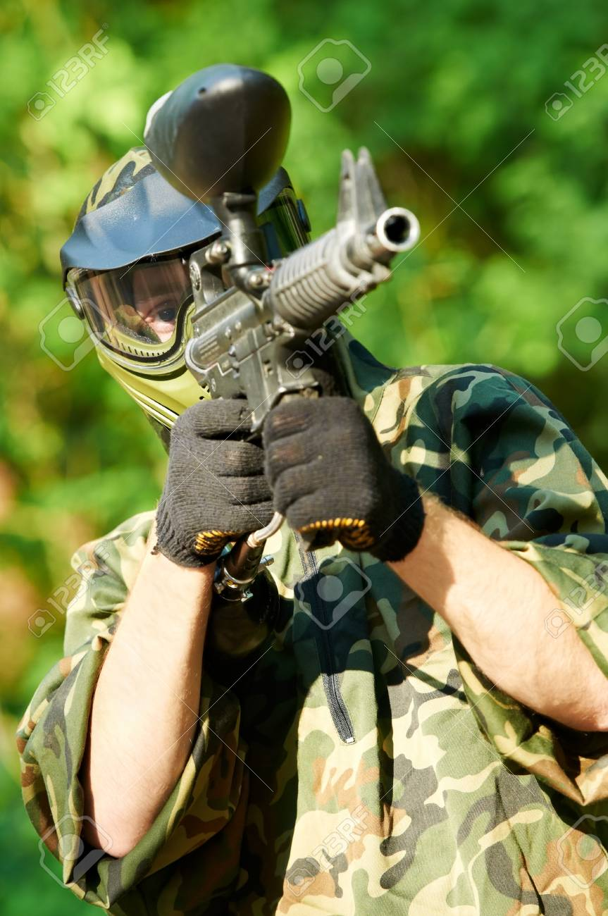 paintball player holding fire Stock Photo - 9920319