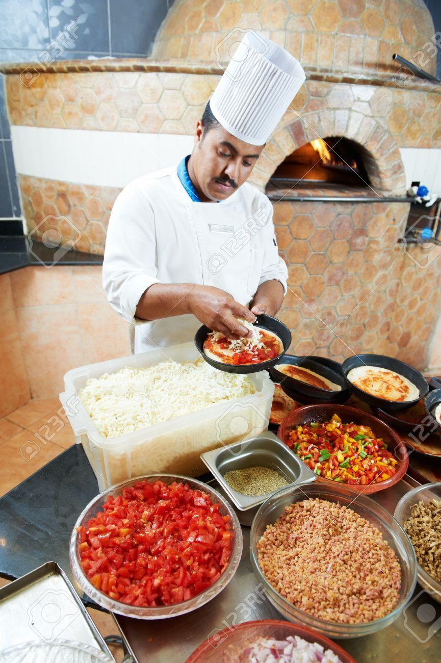 arab pizza arab baker chef making pizza stock photo
