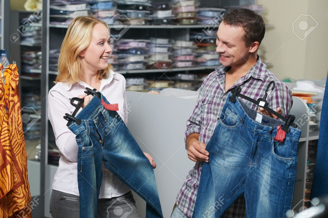Young Couple At Clothes Shopping Stock Photo, Picture And Royalty ...