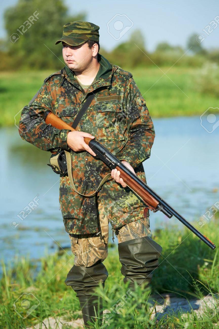 hunter with rifle gun Stock Photo - 10443153