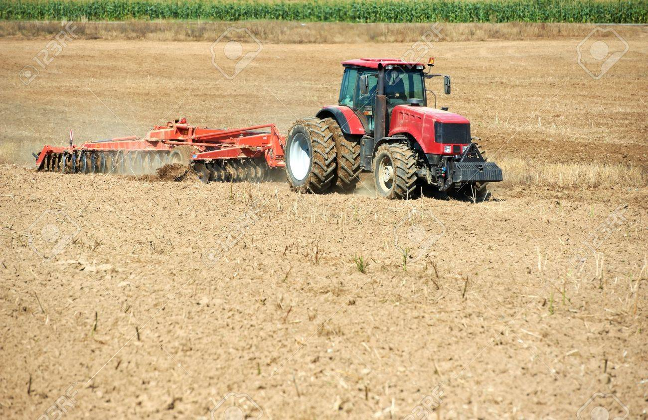 Ploughing tractor at field cultivation work Stock Photo - 10466301
