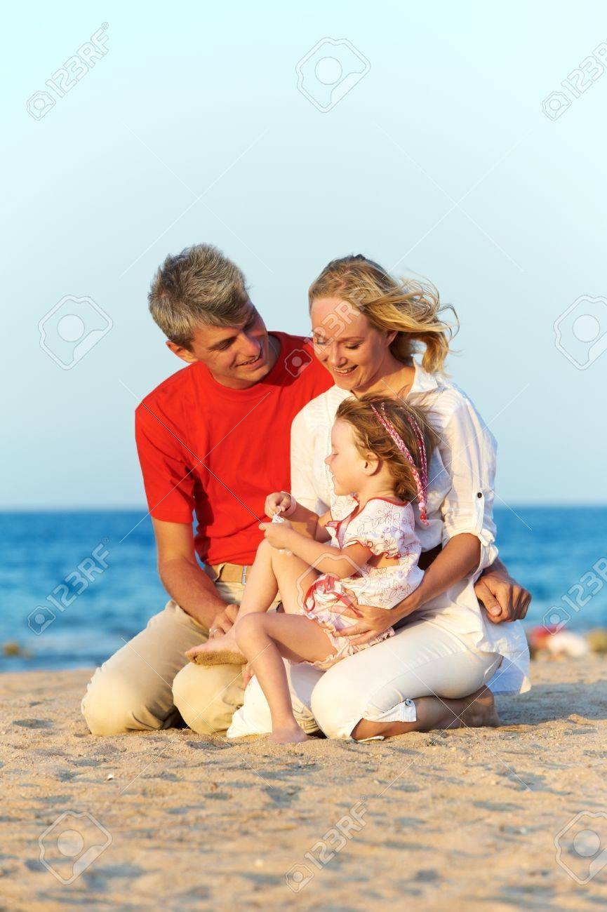 Family with child at sea beach Stock Photo - 10506424