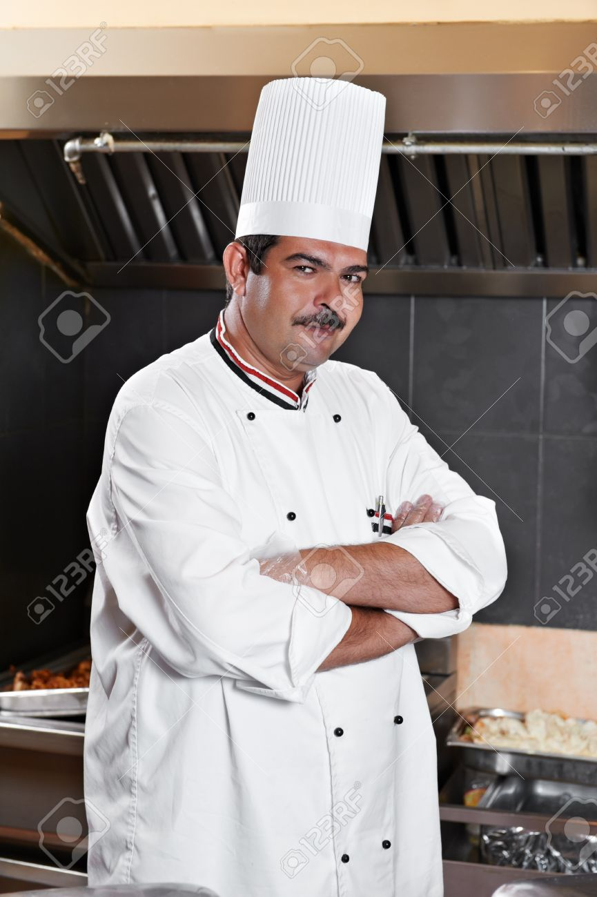 chef in uniform at kitchen Stock Photo - 10506421