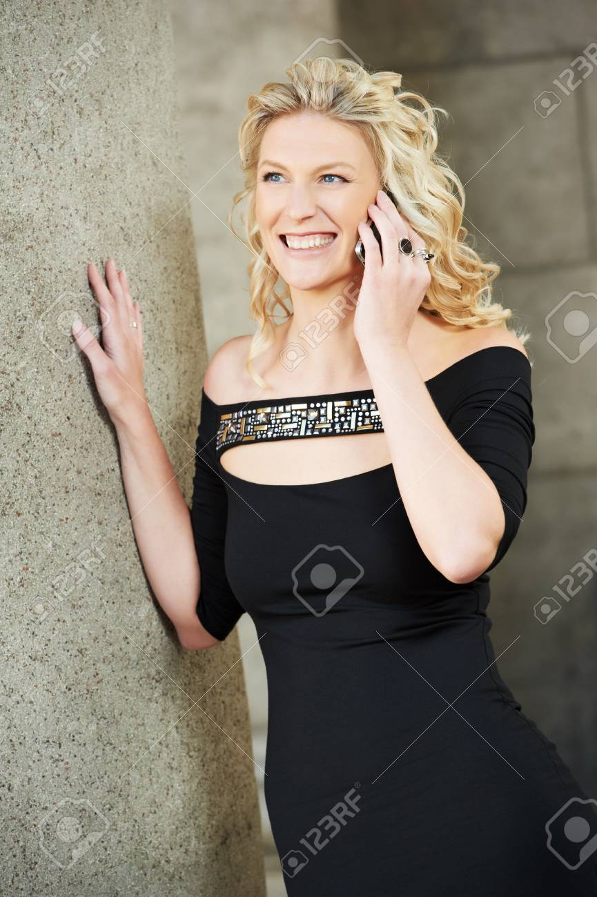 Girl with phone outdoors Stock Photo - 10521423