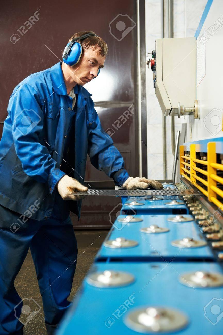worker operating guillotine shears machine Stock Photo - 10521393