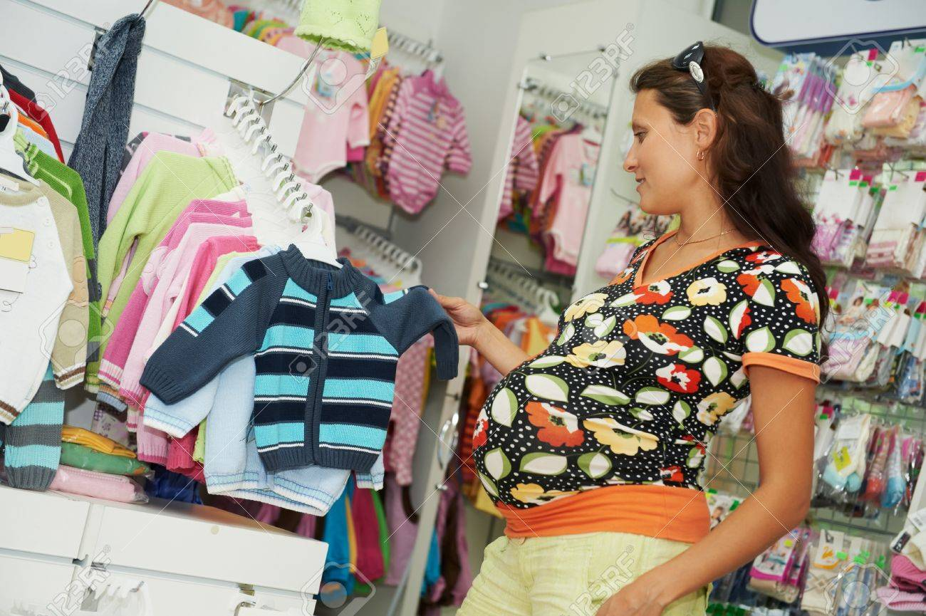 Young pregnant woman at shop Stock Photo - 10698178