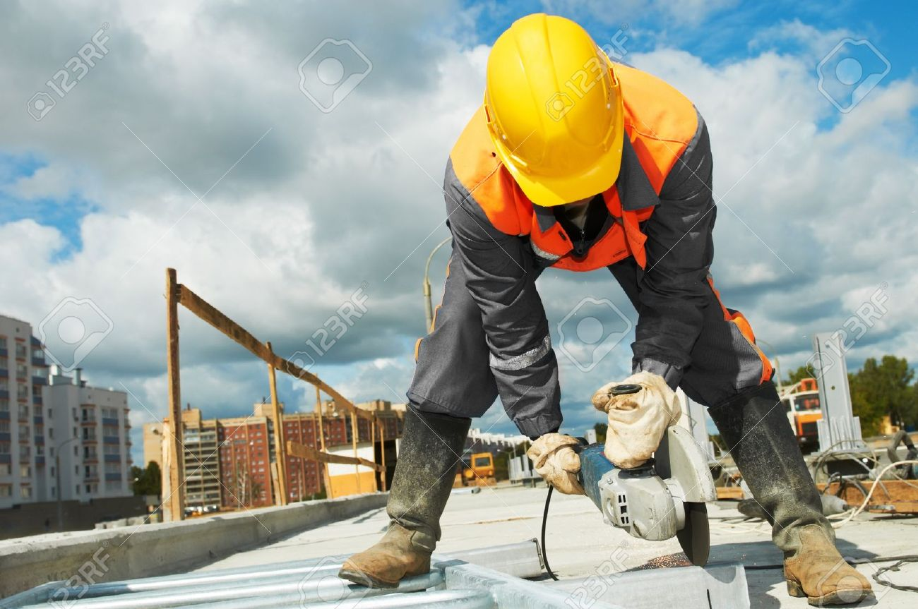 builder working with cutting grinder - 10816022