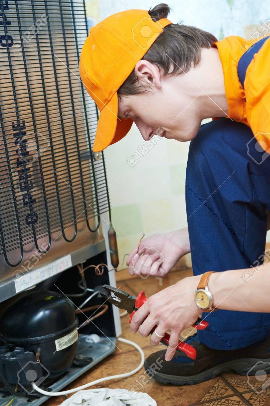 repair work on fridge appliance Stock Photo - 11006367