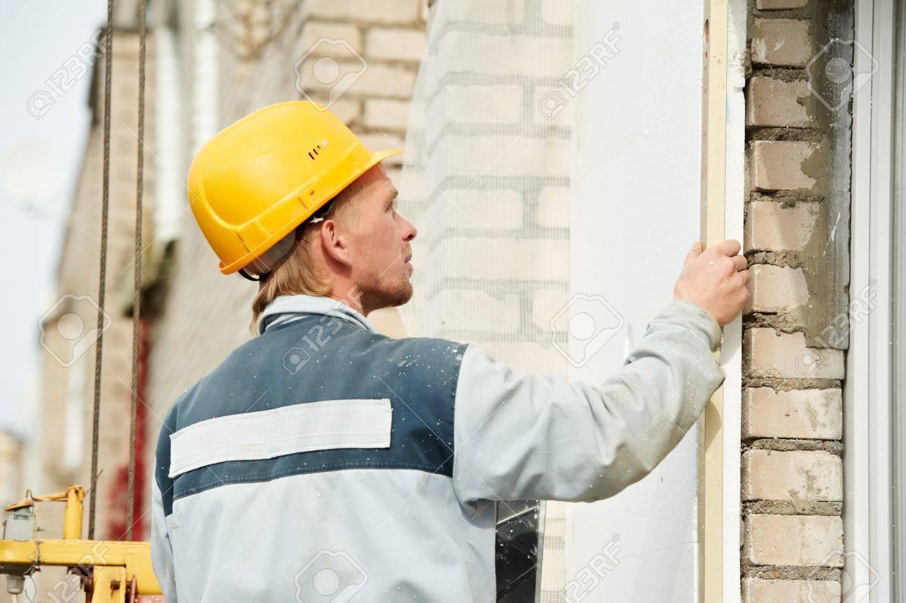 builder facade plasterer worker Stock Photo - 11006374