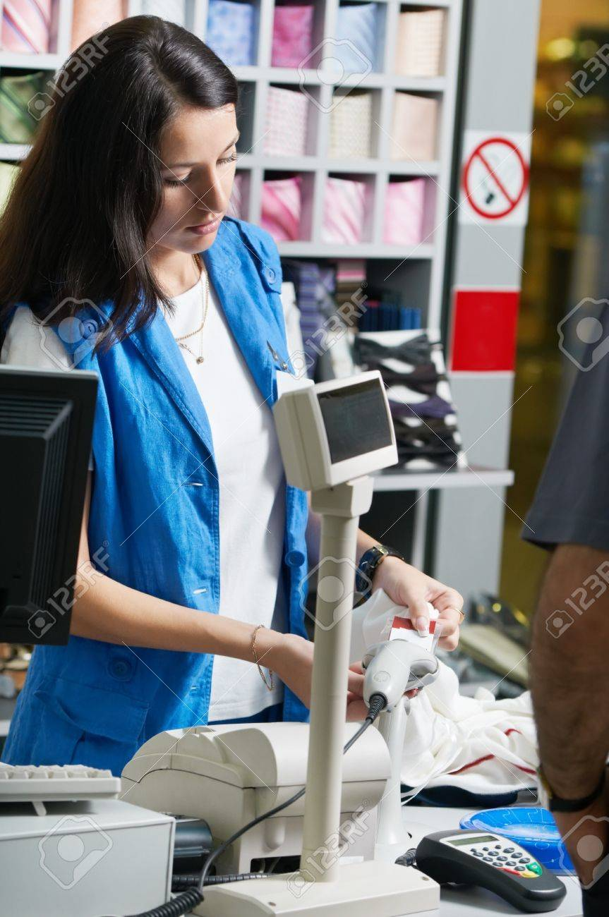 young shop assistant selling clothing in shop stock photo picture stock photo young shop assistant selling clothing in shop