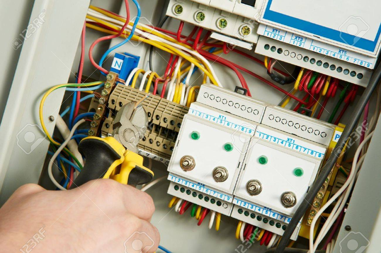 Electrician At Work Stock Photo, Picture And Royalty Free Image ...