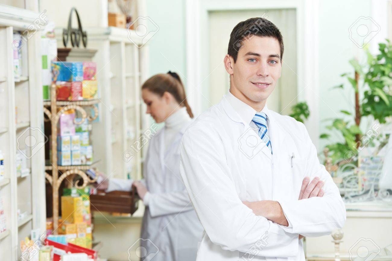 Two Pharmacy chemist workers in drugstore Stock Photo - 12589405