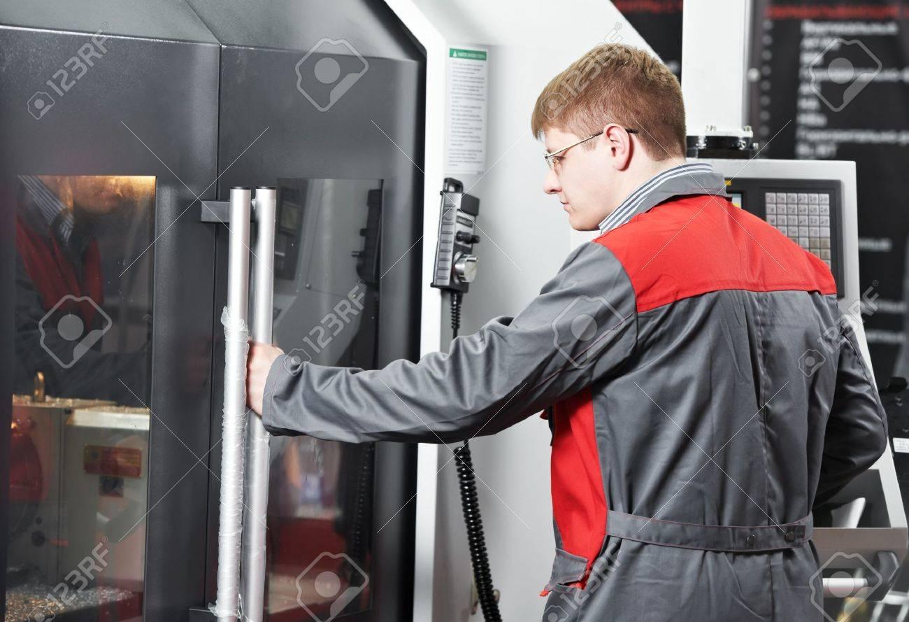 laborer working with machine tool Stock Photo - 12589605