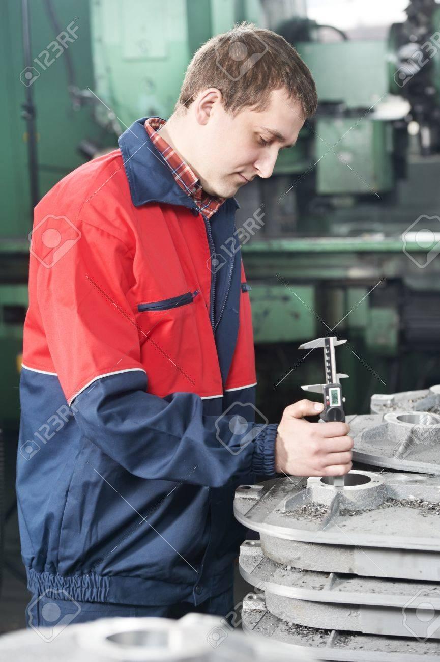 worker measuring detail tool Stock Photo - 12590066