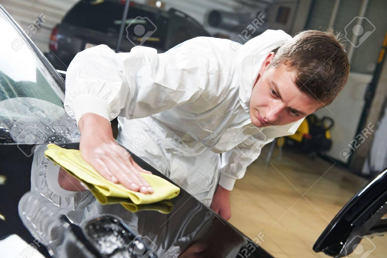 mechanic repairing and polishing car headlight Stock Photo - 13536180