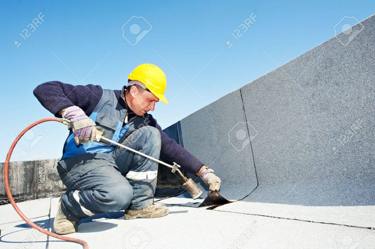 Flat roof covering works with roofing felt Stock Photo - 13536202