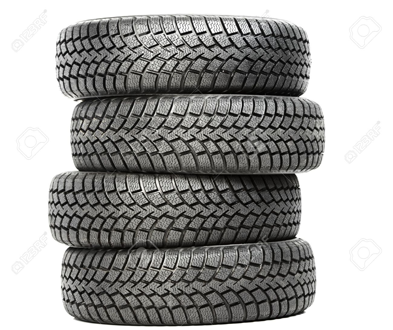 Stack of four car wheel winter tires isolated Stock Photo - 14056978