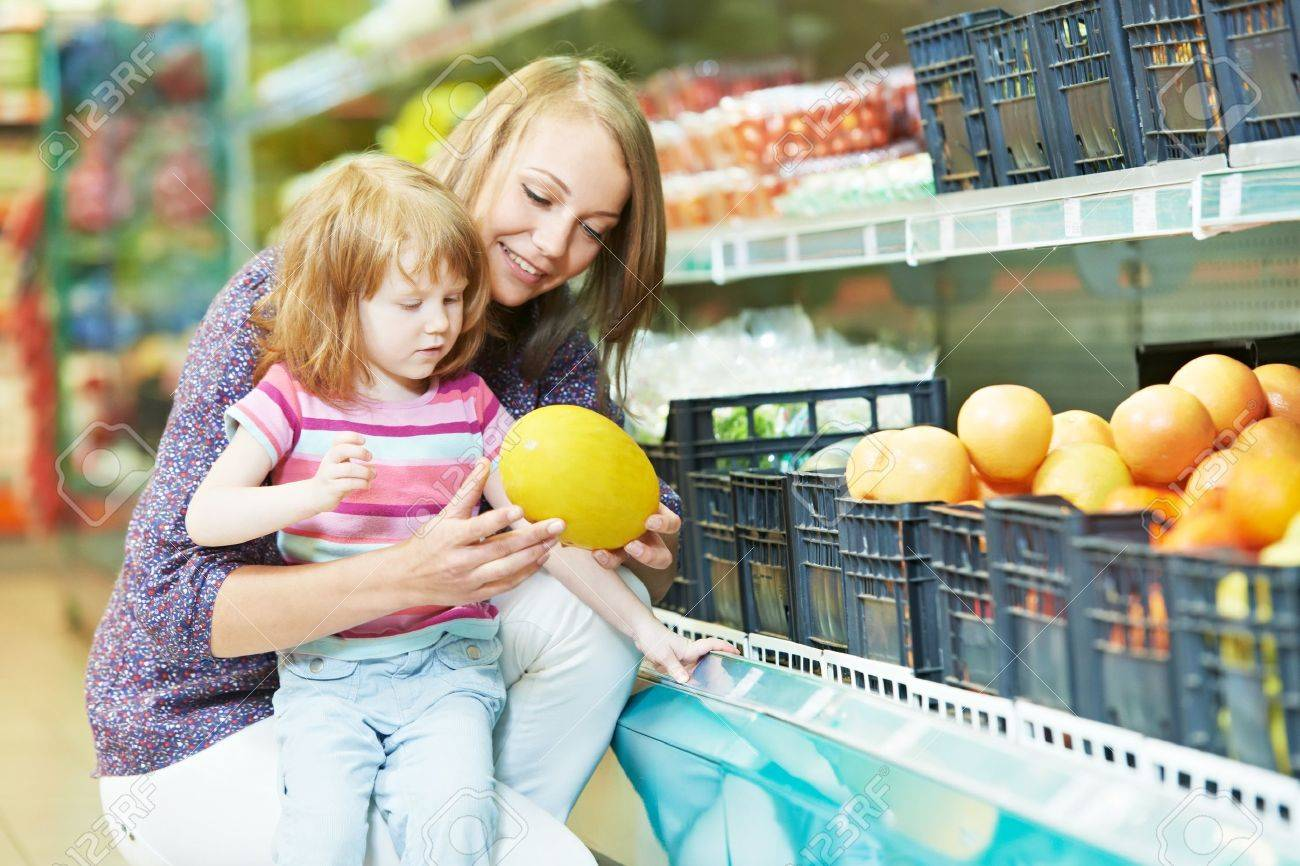 woman and little girl shopping fruits Stock Photo - 14081892
