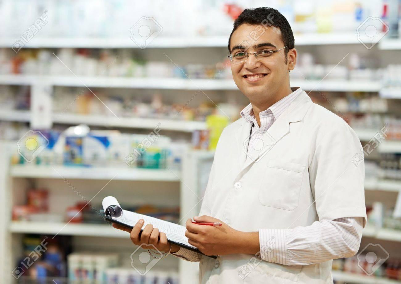 Pharmacy chemist woman in drugstore - 14545628