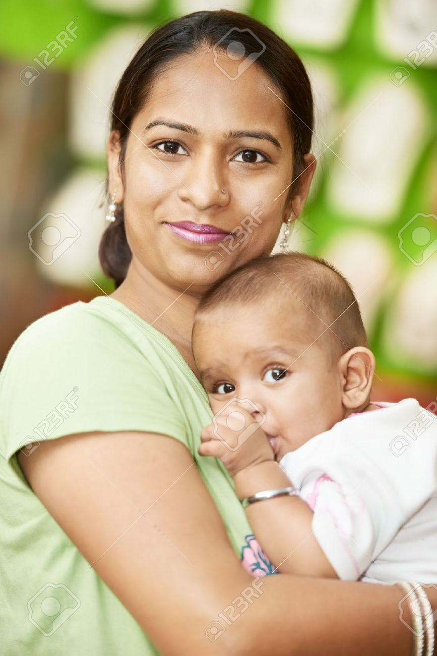 Happy smiling Indian woman mother hugging her little child boy Stock Photo - 21807493