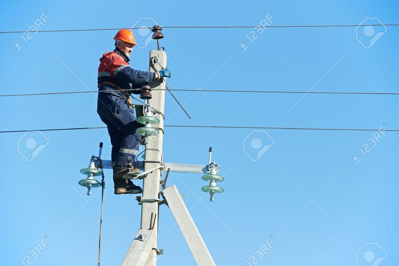 power electrician lineman at work on pole Stock Photo - 15973846