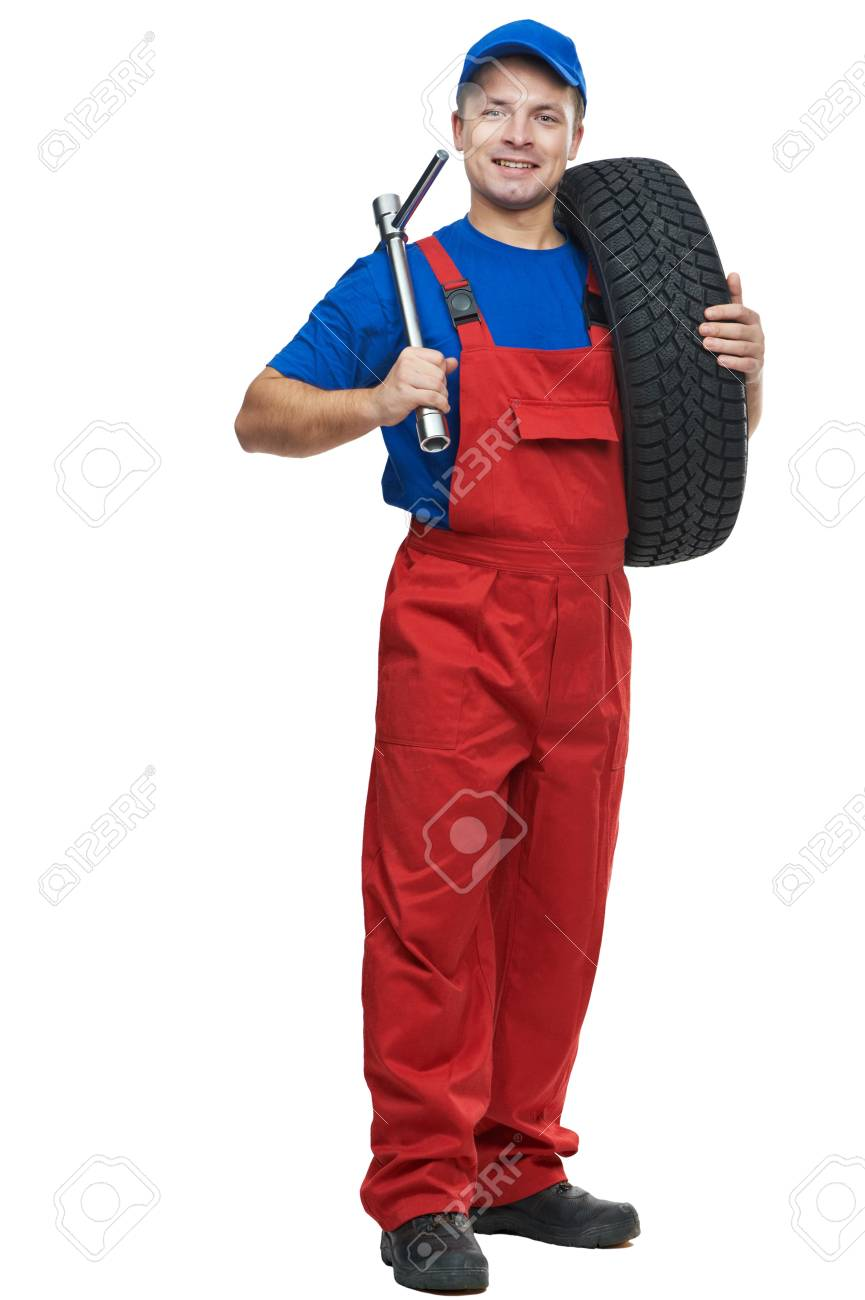 automobile mechanic with car tire and spanner Stock Photo - 16404866