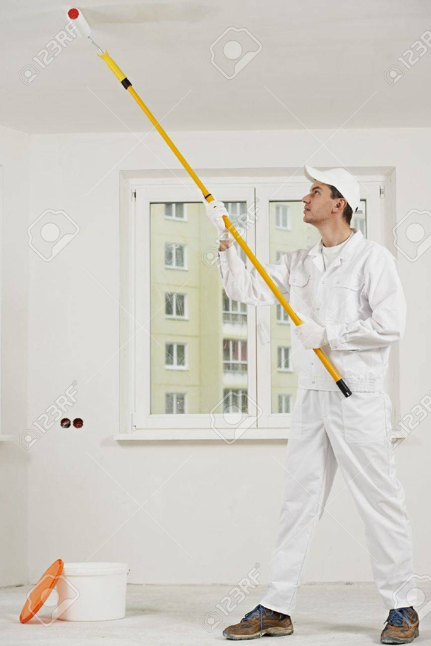 house painter at work with painting roller Stock Photo - 16404868