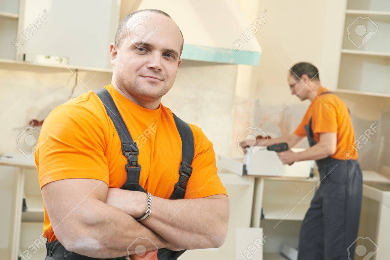 Portrait Of Kitchen Installation Worker Stock Photo, Picture And ...