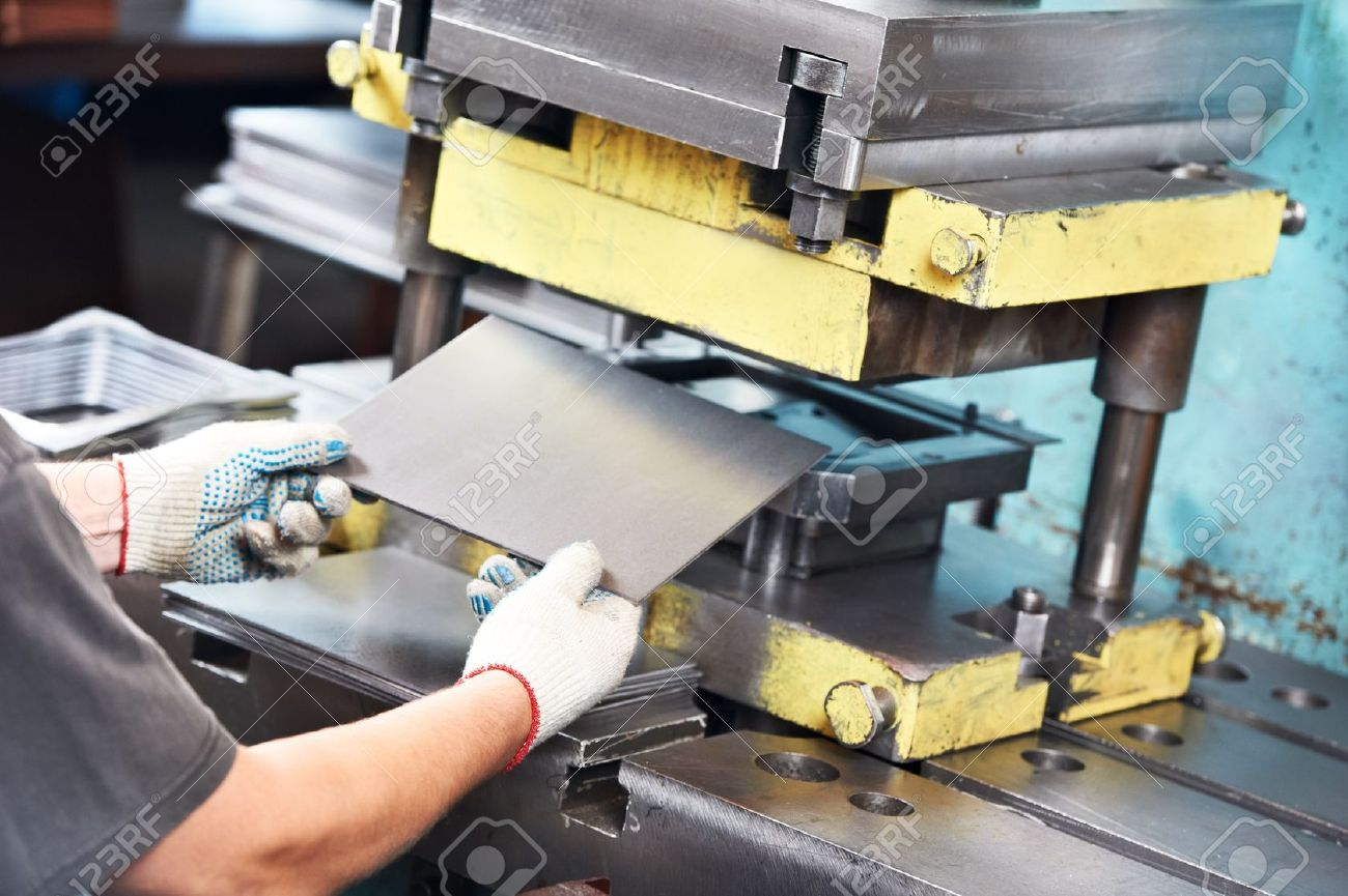 worker operating metal sheet press machine Stock Photo - 18123640