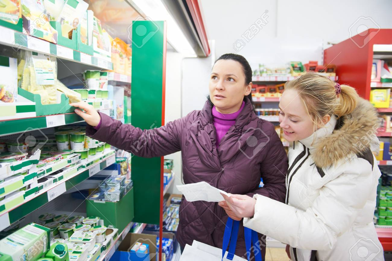 Two women at supermarket dairy shopping Stock Photo - 18123811