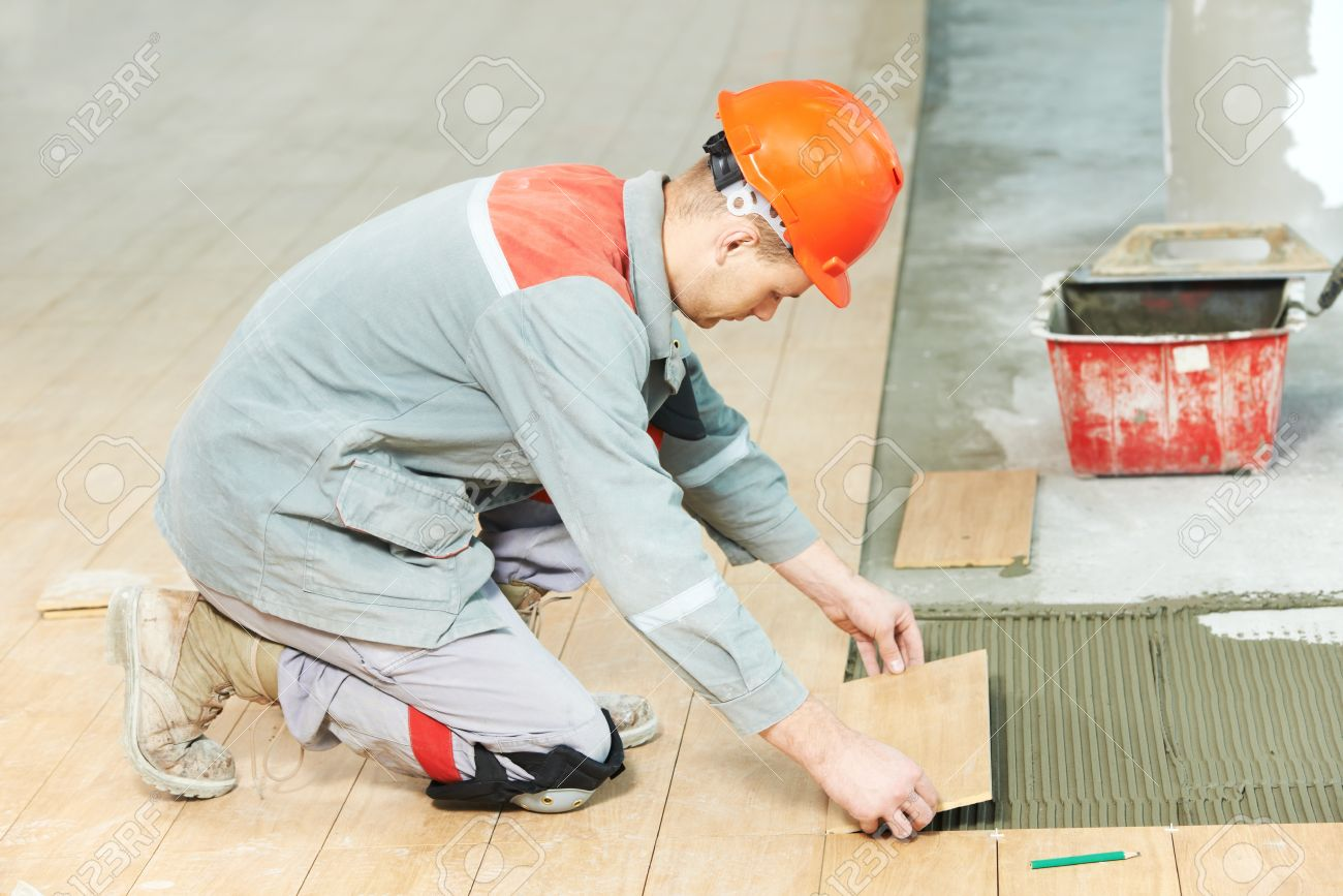 Tiler at industrial floor tiling renovation work stock photo tiler at industrial floor tiling renovation work stock photo 18124010 dailygadgetfo Image collections