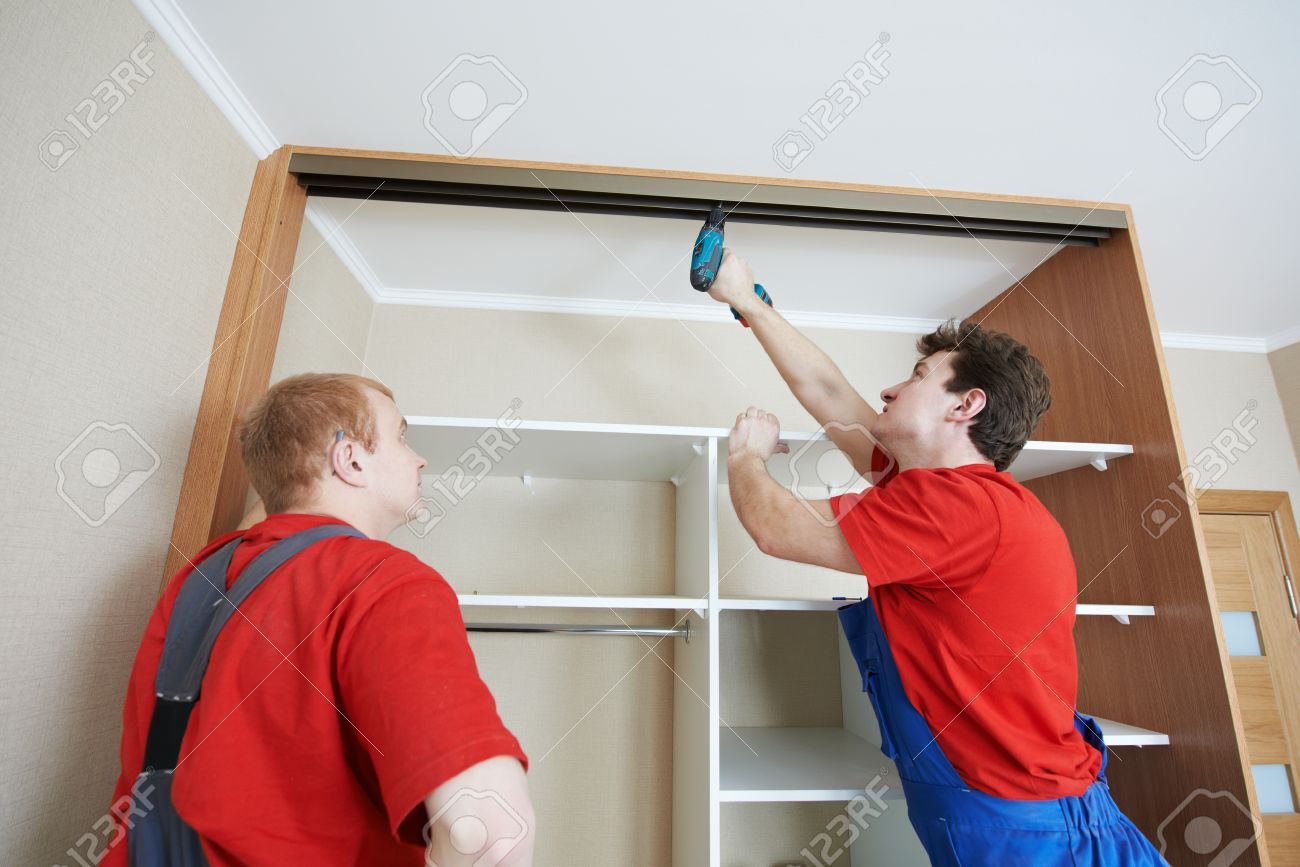 Wardrobe joiners at installation work Stock Photo - 18197107