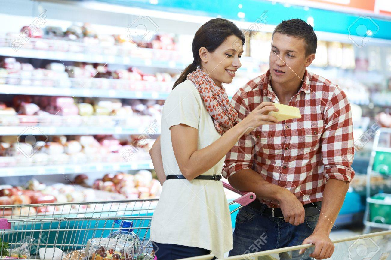 Family choosing food at shopping in supermarket Stock Photo - 18787636
