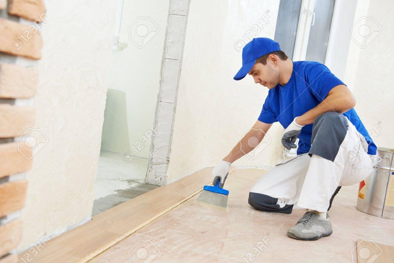 parquet worker adding glue on floor Stock Photo - 18872312