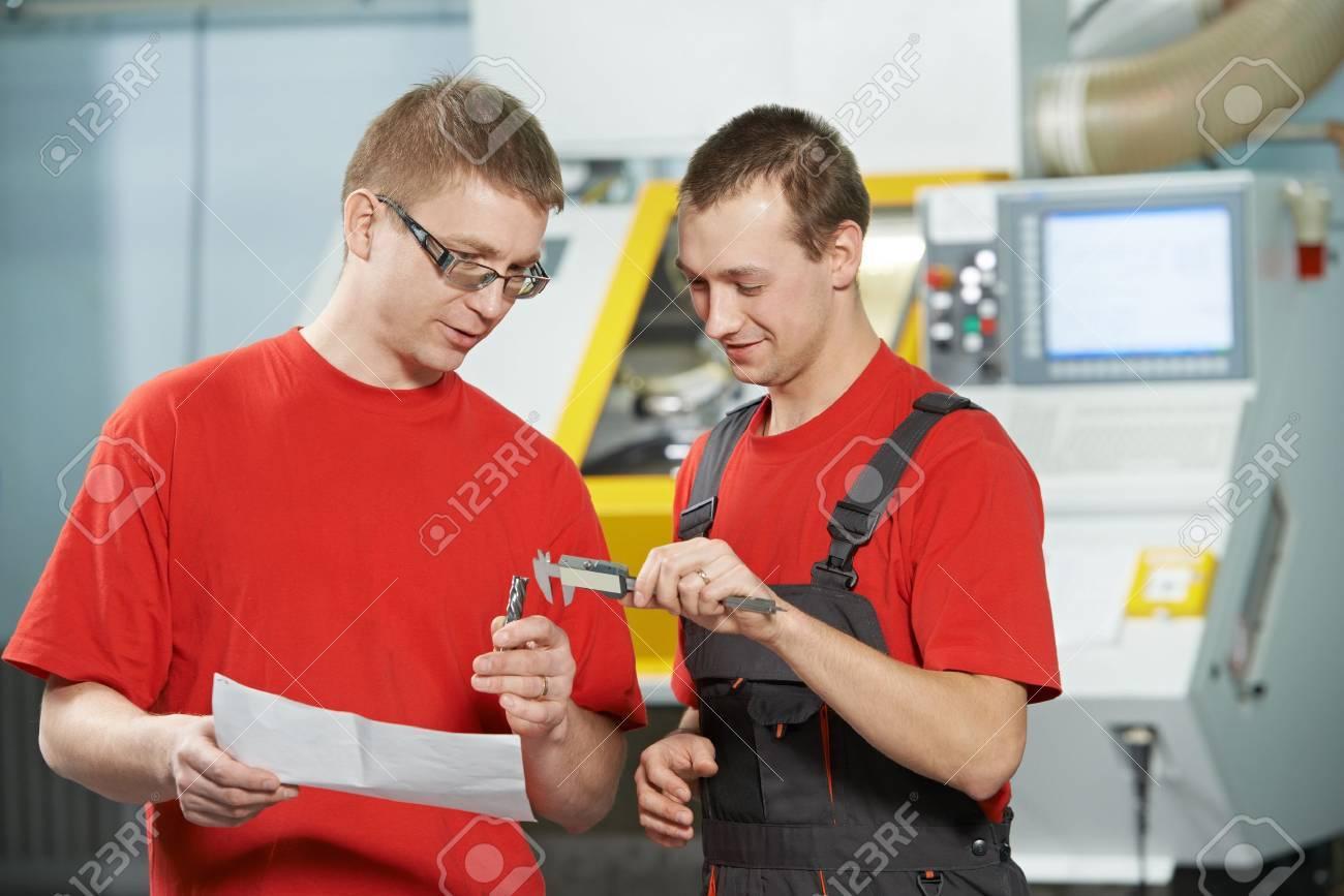 industrial workers at tool workshop - 18877134