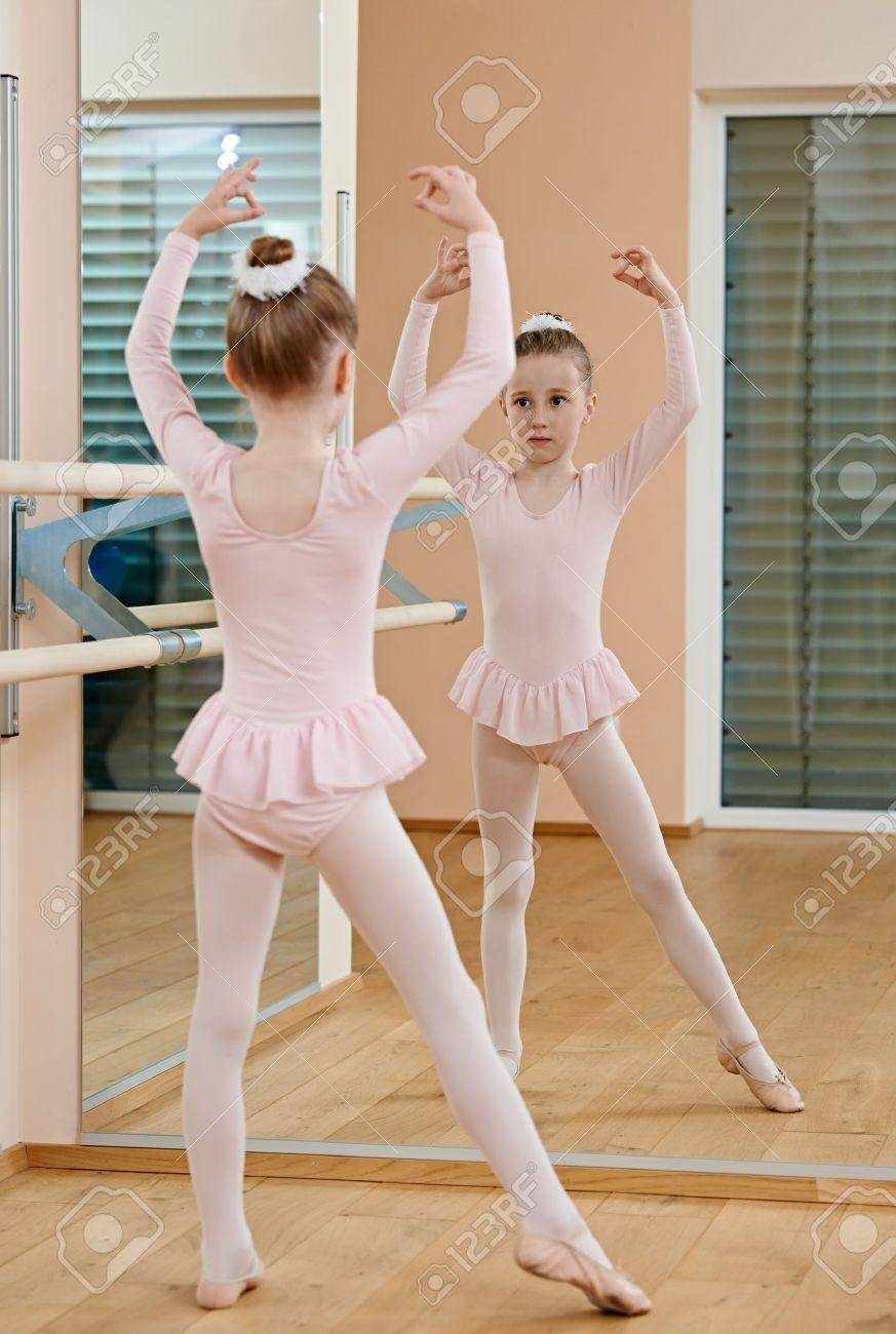 2fee11bb8517 Little Girl At Ballet Training Stock Photo