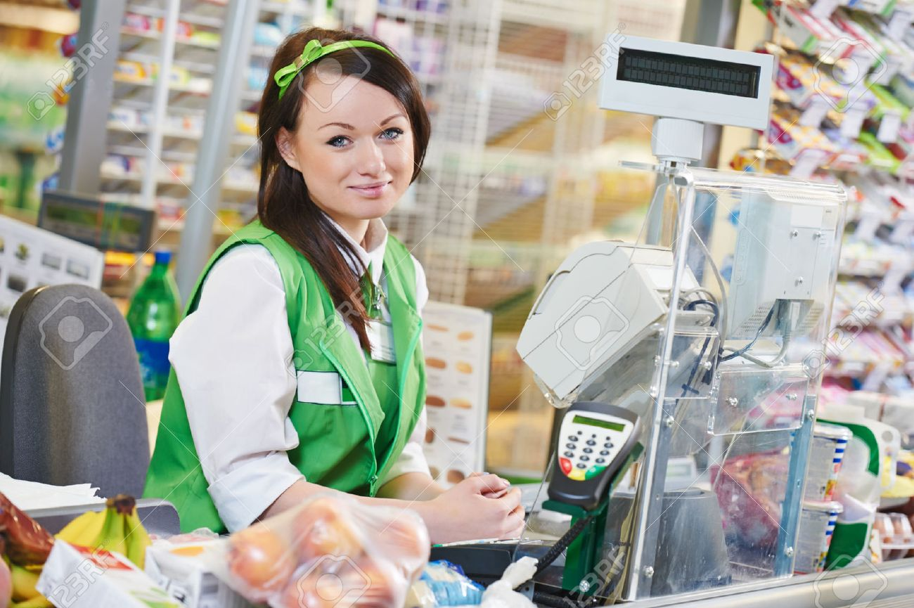 portrait of sales assistant or cashdesk worker in supermarket    stock photo   portrait of sales assistant or cashdesk worker in supermarket store