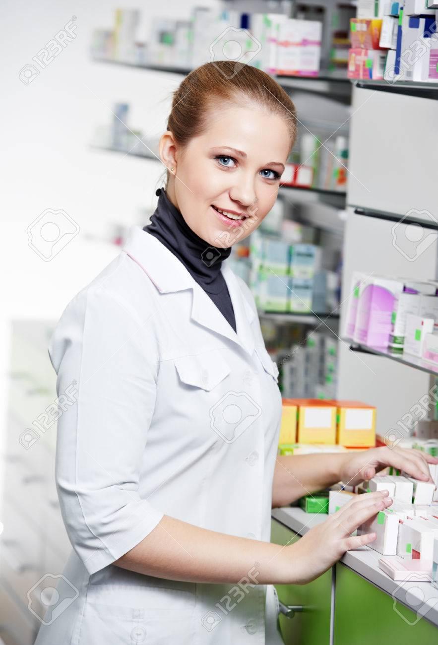 cheerful pharmacist chemist woman standing in pharmacy drugstore Stock Photo - 22844739