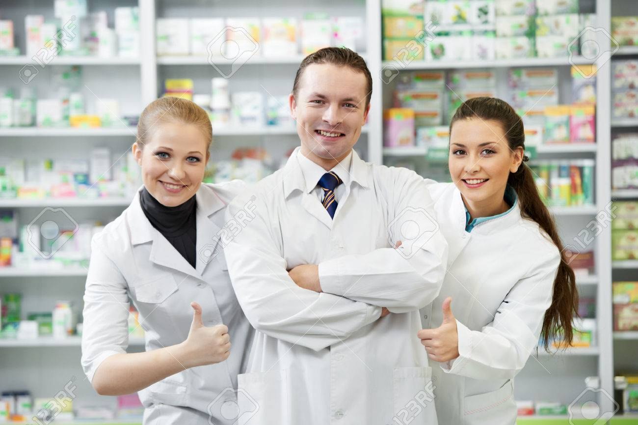 Team of cheerful pharmacist chemist standing in pharmacy drugstore Stock Photo - 22801611