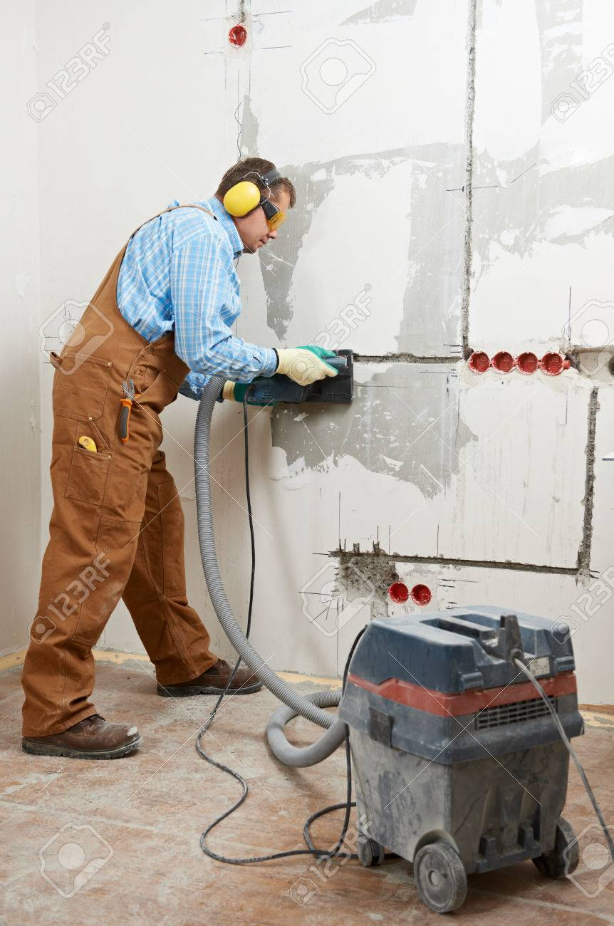 One Electrician Worker At Wiring Cable And Light Switch Or Power A Switched Wall Outlet Socket Installation Work
